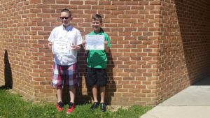 Jay and Cameron with their diplomas