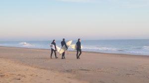 Brave surfers in December
